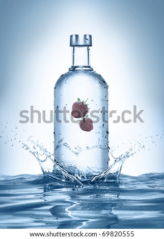 bottle with splashes and strawberries. see more on my page - stock photo