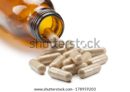 bottle with vitamin supplements on white background - stock photo