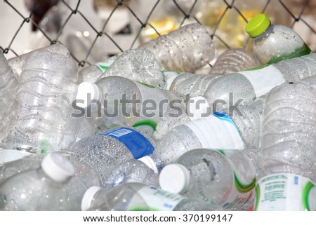 Bottled water is then used to separate plastic bottles in the basket. - stock photo