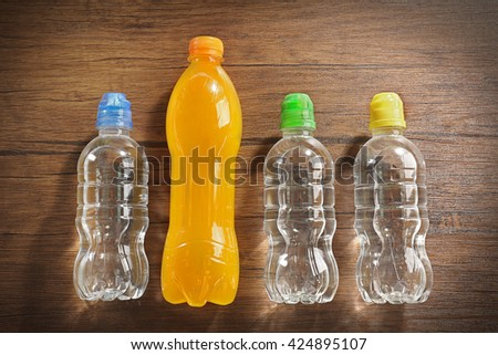 Bottled water on the wooden table, close up - stock photo