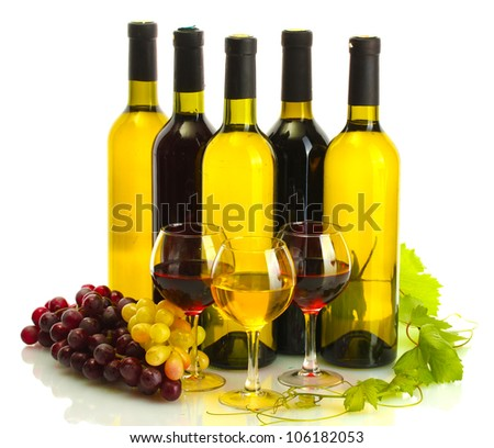 bottles and glasses of wine and ripe grapes isolated on white - stock photo