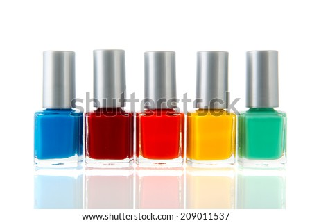 Bottles colorful nail polisch isolated over white background - stock photo