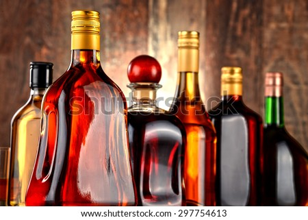 Bottles of assorted alcoholic beverages. - stock photo