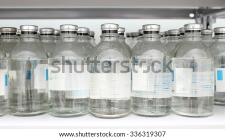 Bottles of chemicals in warehouse - stock photo