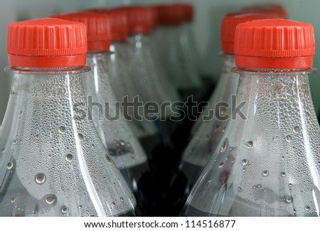 bottles of cola with drops - stock photo