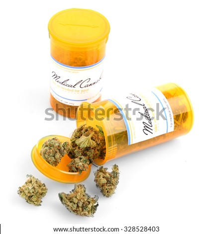Bottles of dry medical cannabis isolated on white - stock photo