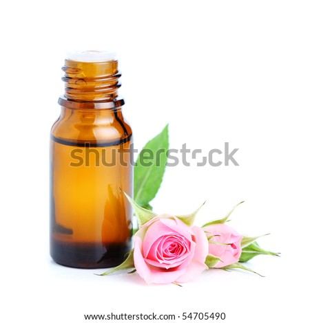 bottles of essential oil and pink rose  white isolated background - stock photo