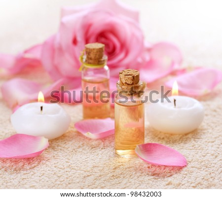 Bottles of Essential Oil for Aromatherapy . Rose Spa - stock photo