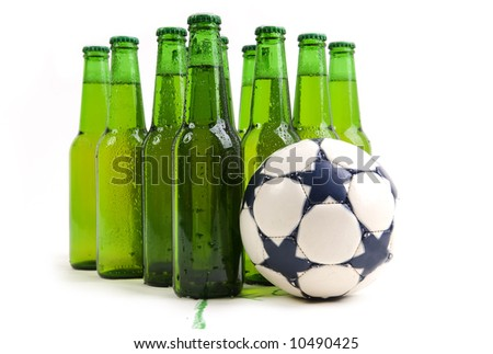 Bottles of fresh beer with soccer ball - stock photo