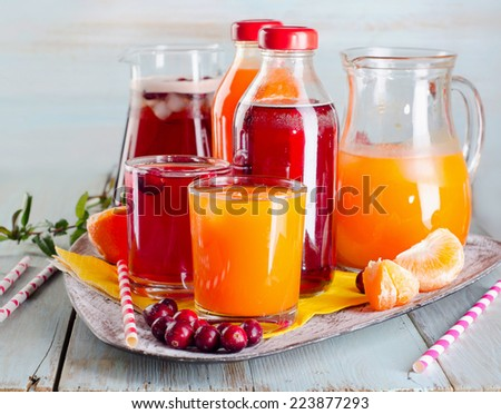 Bottles of Fresh juices on  wooden table. Selective focus - stock photo