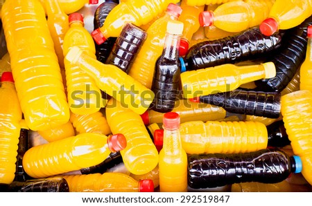Bottles of freshly squeezed juice at a market - stock photo