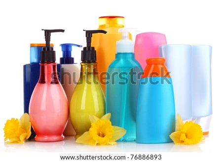 bottles of health and beauty products on white background - stock photo