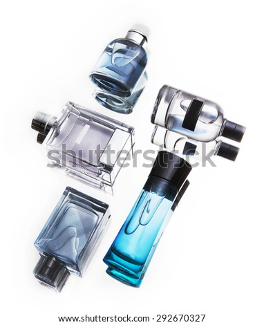 bottles of perfumes composition isolated - stock photo