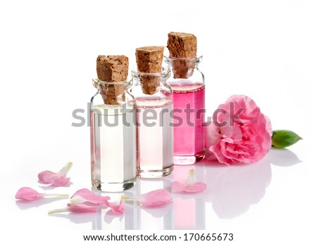 Bottles of Spa essential oils for aromatherapy - stock photo