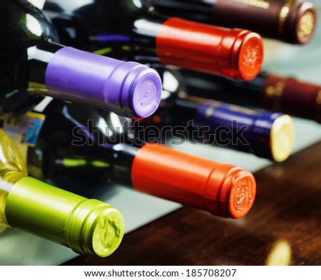 Bottles of wine in a winery. Red and white wine. - stock photo