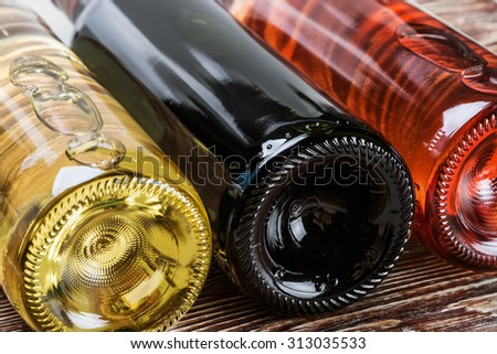 bottles of wine of different sorts. Focus in the middle of the frame. Shallow depth of field - stock photo