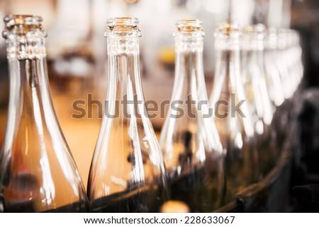 bottles on the conveyor belt - stock photo