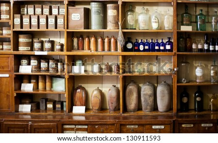 Bottles on the shelf in old pharmacy - stock photo
