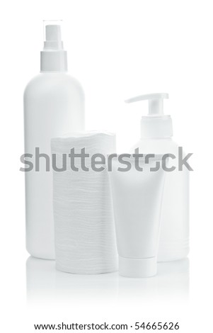 bottles pads and tube isolated - stock photo