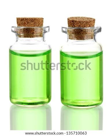 Bottles with basics oils isolated on white - stock photo
