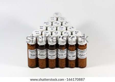 Bottles with different homeopathic remedies - stock photo