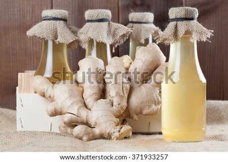 Bottles with homemade ginger syrup. Shallow dof - stock photo