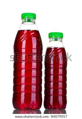 Bottles with juice isolated on white - stock photo