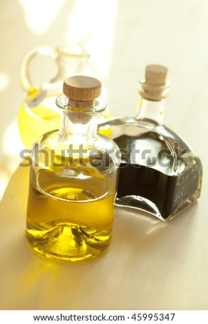 Bottles with oil and balsamic vinegar - stock photo