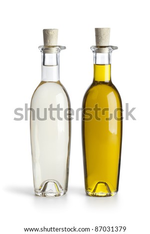 Bottles with oil and vinegar on white background - stock photo