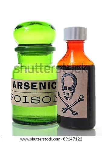 Bottles with poison or skull and cross bones label. - stock photo