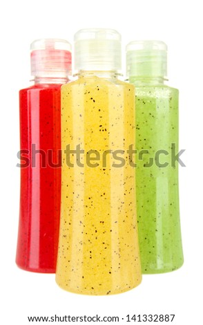 Bottles with scrub isolated on white - stock photo