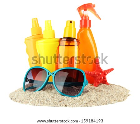 Bottles with suntan cream and sunglasses, isolated on white - stock photo