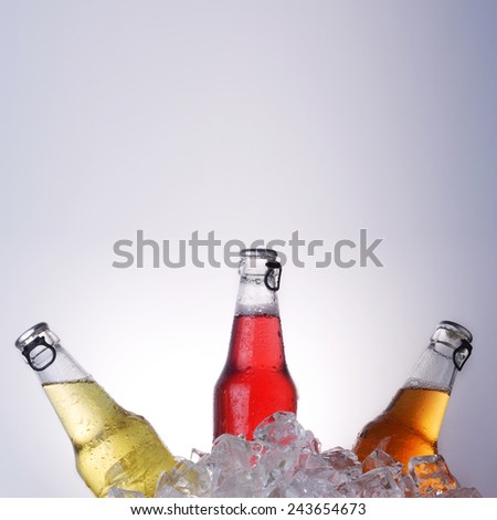 bottles with tasty drink in ice - stock photo