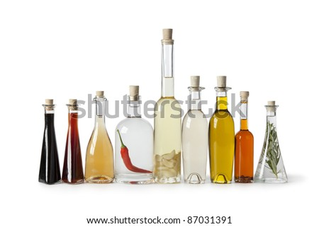 Bottles with various  types of oil and vinegar on white background - stock photo