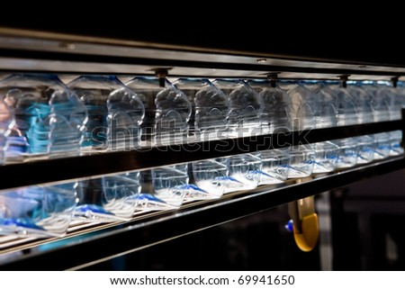 bottling water on the plant - stock photo