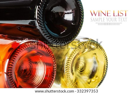 bottom of the bottles of wine of different sorts. Shallow depth of field. Text example and removed - stock photo