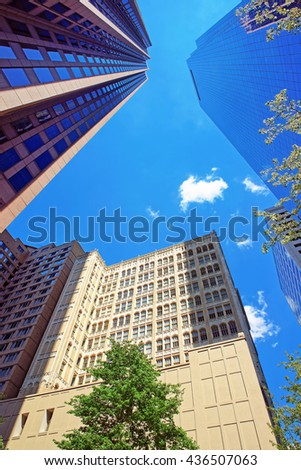 Bottom up view of skyscrapers mirrored in glass in Philadelphia, Pennsylvania, USA. It is central business district in Philadelphia - stock photo