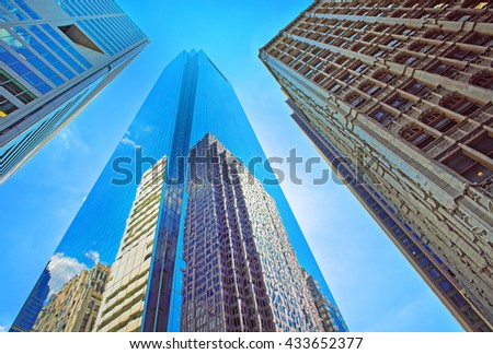 Bottom-up view of skyscrapers reflected in glass in Philadelphia, Pennsylvania, USA. It is central business district in Philadelphia - stock photo