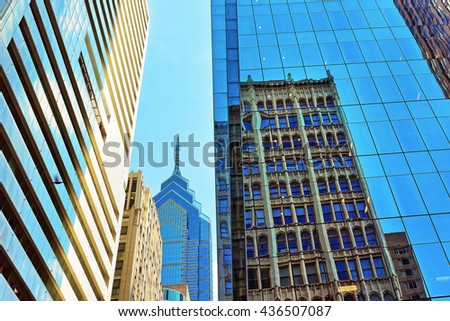 Bottom-up view on skyscrapers reflected in glass in Philadelphia, Pennsylvania, USA. It is central business district in Philadelphia - stock photo