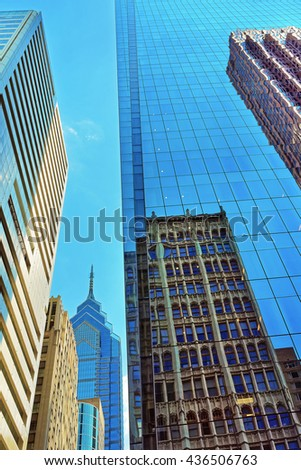 Bottom up view to skyscrapers reflected in glass in Philadelphia, Pennsylvania, USA. It is central business district in Philadelphia - stock photo