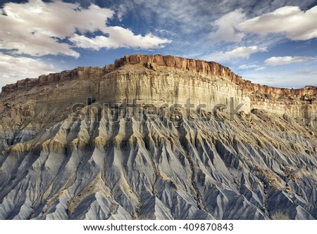 bottom view of a blue rocky cliff in Utah - stock photo
