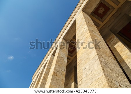 Bottom view of Anitkabir, mausoleum of turkish leader Ataturk, on bright blue sky background. - stock photo