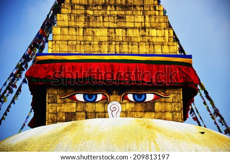 Boudhanath or Bodnath Stupa with Buddha eyes or Wisdom eyes is the largest stupa in Nepal and the holiest Tibetan Buddhist temple outside Tibet. It is the center of Tibetan culture in Kathmandu. - stock photo
