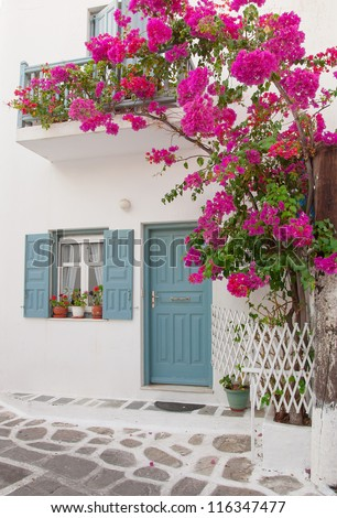 Bougainvillea flowers around the house with a balcony and tsvetami.Mikonos. - stock photo