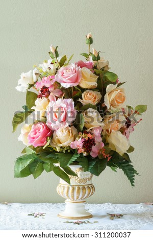 Bouquet flower in the vase on the brown background - stock photo