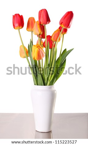 Bouquet from tulips in china vase isolated on white - stock photo