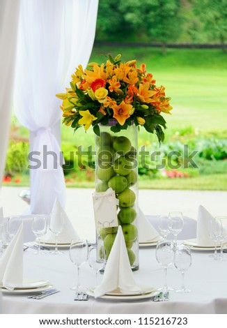 Bouquet in vase on decorating wedding table - stock photo