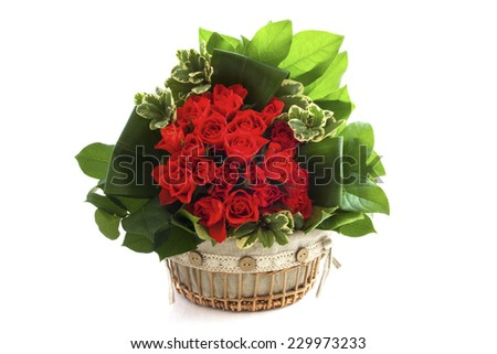 Bouquet in wooden decorative basket isolated over white - stock photo
