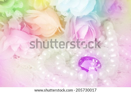 Bouquet, Jewelry and Pearls Necklace with Soft Focus Color Filtered as Background. - stock photo