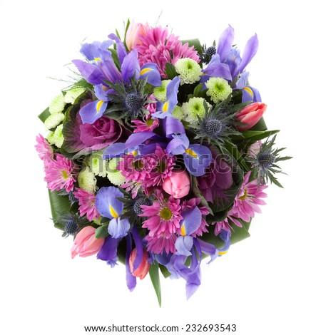 Bouquet made of Iris, Chrysanthemum, Eryngium and tulip flowers seen from above. - stock photo
